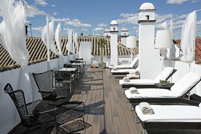 Sol y los tejados de Sevilla desde la terraza del HOSPES.